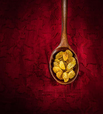Raisins on a wooden spoon - Royalty free stock photo, image