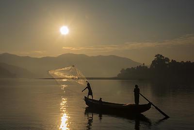 Fishing at sunrise - Royalty free stock photo, image