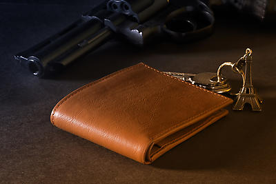 Wallet and weapon - Royalty free stock photo, image