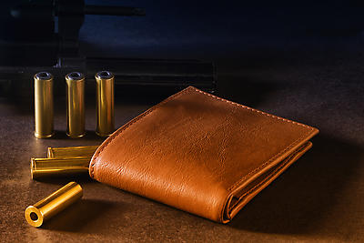 Wallets and bullets - Royalty free stock photo, image