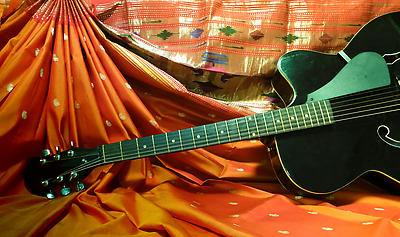 Still life of guitar with India saree at background - Royalty free stock photo, image