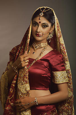 Indian bride with bridal make-up, jewelry and ethnic wear - Royalty free stock photo, image