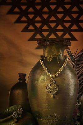 Antique jewelry set mounted on pot - Royalty free stock photo, image