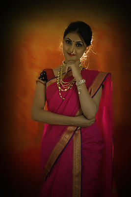 Portrait of Indian lady with bridal make-up and jewelry - Royalty free stock photo, image