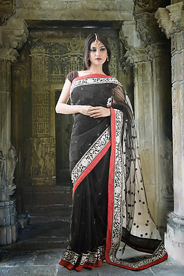 Indian lady in black designer saree with old temple background - Royalty free stock photo, image