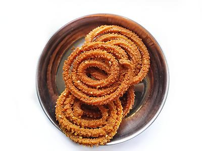 Chakali or murukku or chakri isolated on white background  - Royalty free stock photo, image