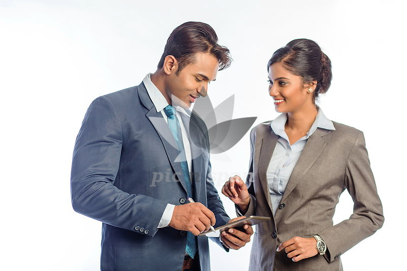 Man and woman in office - Royalty free stock photo, image