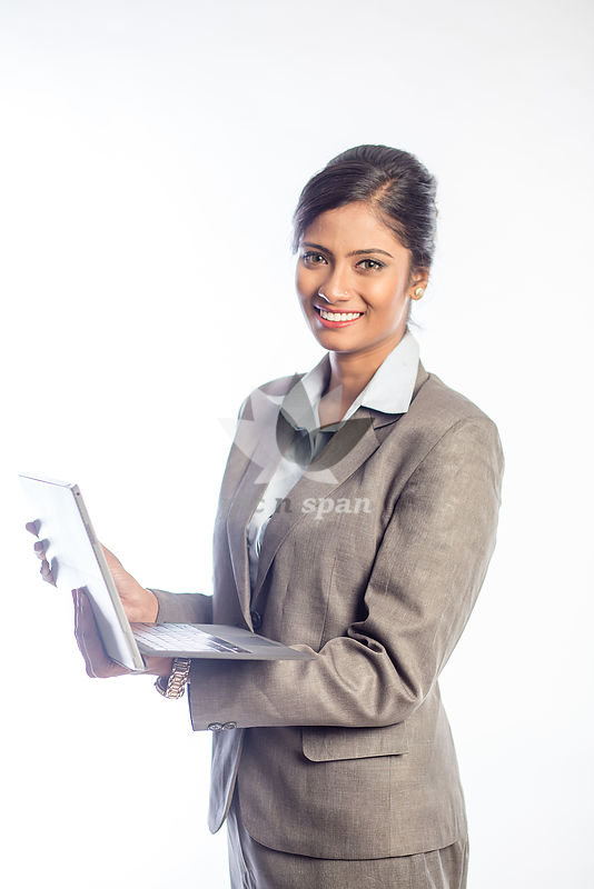 Woman working on laptop in office - Royalty free stock photo, image