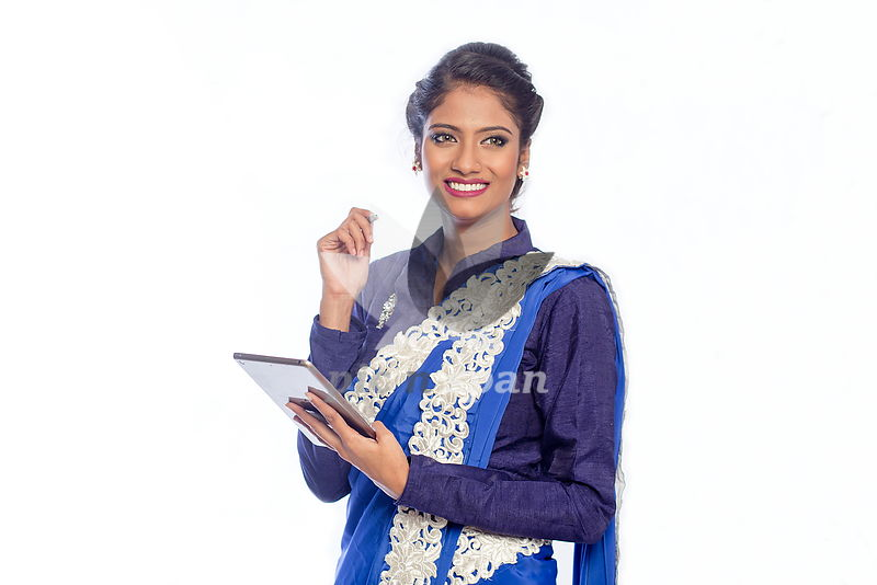 Woman with tablet in hand - Royalty free stock photo, image
