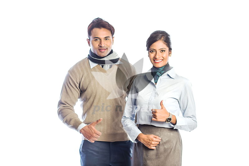 Young man and woman - Showing thumbs up - Royalty free stock photo, image