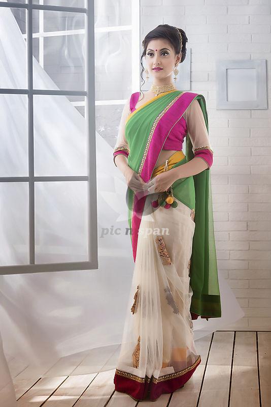 Indian woman wearing designer wear saree - Royalty free stock photo, image
