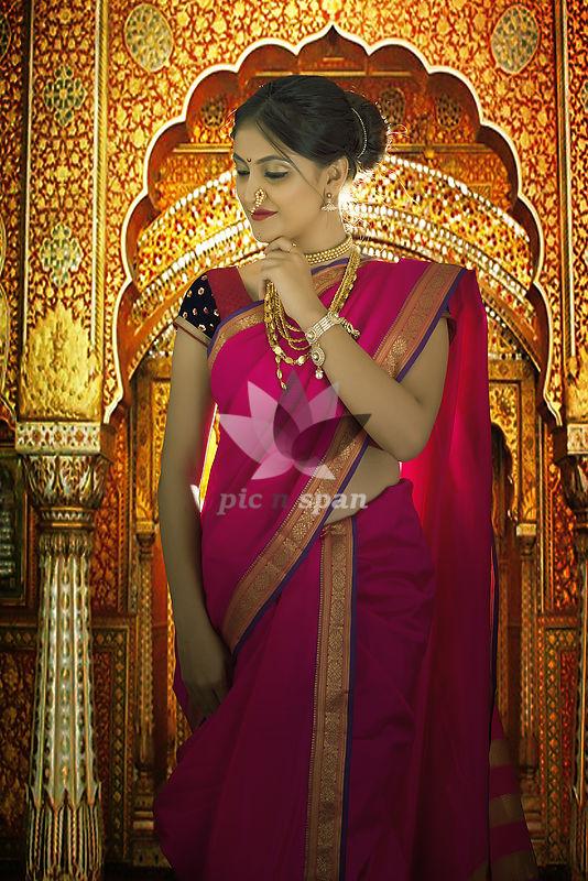 Indian woman in traditional nawari saree - Royalty free stock photo, image