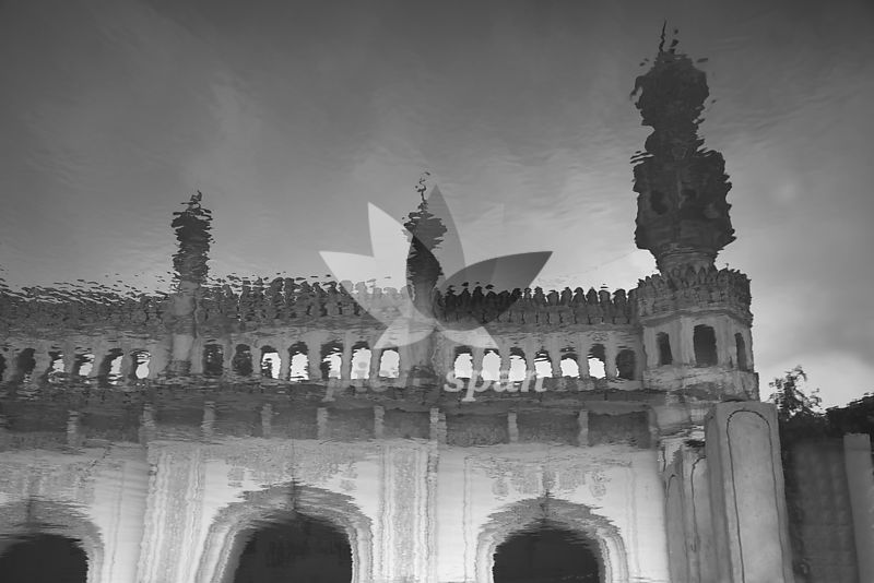 Reflection of mosque in water. Paigah tomb masjjid - Royalty free stock photo, image