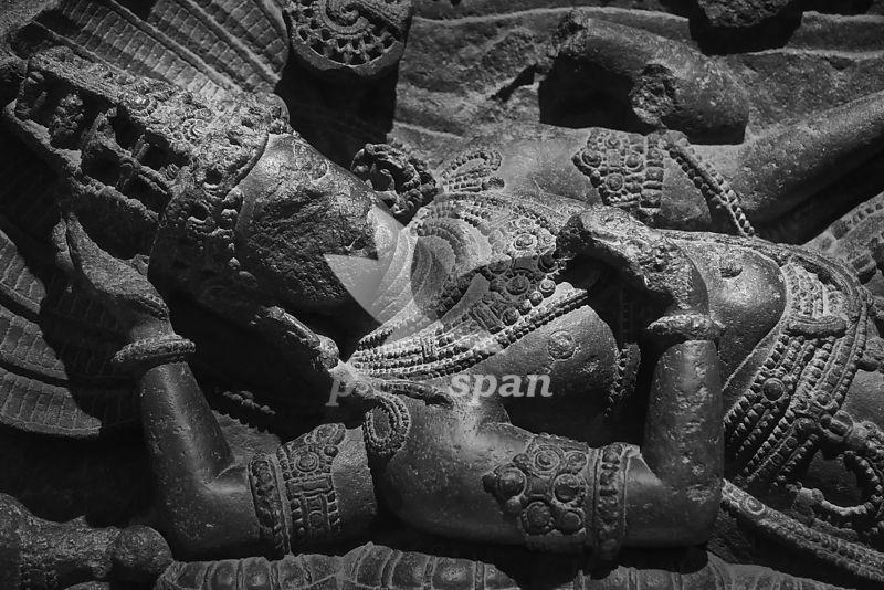 Reclining monolithic idol of Lord Vishnu - Royalty free stock photo, image
