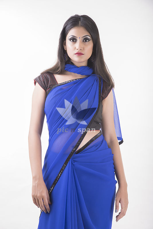 Indian woman in blue chiffon saree as fashion icon - Royalty free stock photo, image