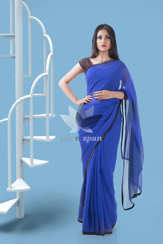 Indian woman in Georgette blue saree - Royalty free stock photo, image