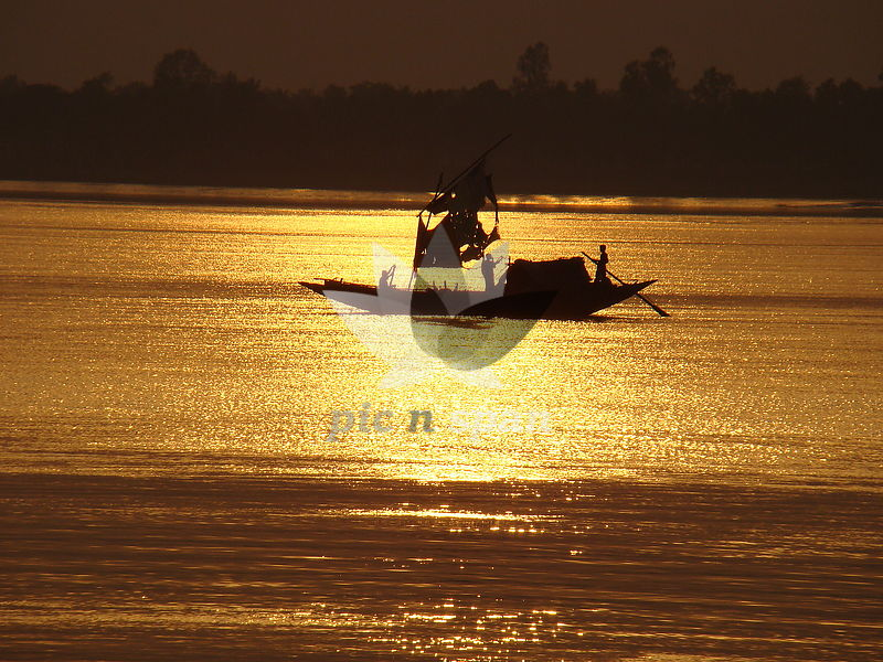Sunset at River Ganges - Royalty free stock photo, image